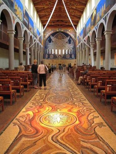 At the Church of the Transfiguration, the mosaic floor runs the length of the sanctuary to the glass mosaic behind the altar in the apse.