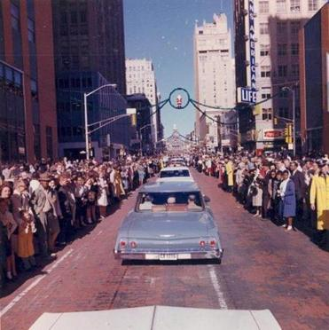 A view of the motorcade taking President Kennedy through downtown Dallas on Nov. 22, 1963.