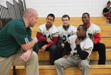 Coach Tim Phelps met with captains (from left) Kenneth Khun, Brad Scuzzarella, Jordan Brown and Romario Louidhon at Lynn Cassical High School.