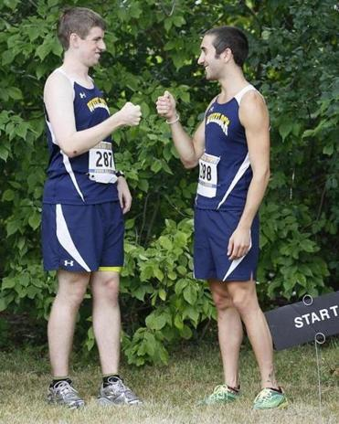 Patrick Holland (left) and Alexander Kriz help anchor the Wheelock College cross-country team.
