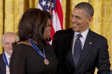 President Barack Obama talks with Oprah Winfrey after presenting her with the Presidential Medal of Freedom,