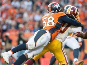 Von Miller is good at collapsing the pocket — and the quarterback. (Photo by Dustin Bradford/Getty Images)