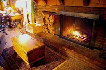 The woodburning fireplace in the common room lounge of the Quechee Inn at Marshland Farm is a welcome winter amenity.