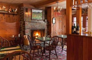 The fireplace in the pub of the Inn at Weston makes a cozy spot to gather in cold weather.