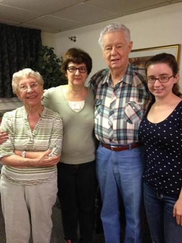 Ellen Reardon, second from left, with her stepmother Arlene Rainey, her father Richard Rainey and her daughter Hannah, in Atlantic, Iowa, last month.