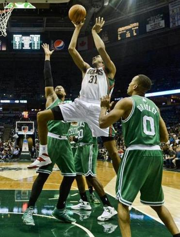Bucks forward John Henson (center) got off a shot while sandwiched between Jared Sullinger and Avery Bradley during Saturday night's game. The Celtics aren't the hot item on the sports scene, but they're still full of Celtic pride, Bob Ryan writes.