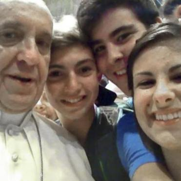 Pope Francis had his picture with a mobile phone taken inside St. Peter's Basilica with Italian youths.