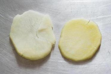 TIP Yukon Gold potatoes (at right) work well in gratins, keeping their texture without turning mushy as russet potatoes (left) tend to do.