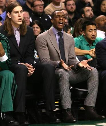 It shouldn't be long before Rajon Rondo trades the jacket and tie for his game uniform.(Barry Chin/Globe Staff),