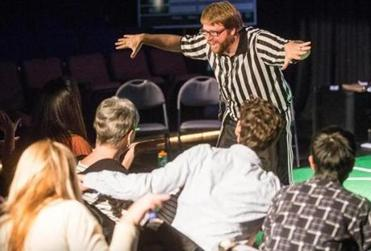 Referee Ben Moser performed during a ComedySportz  show.