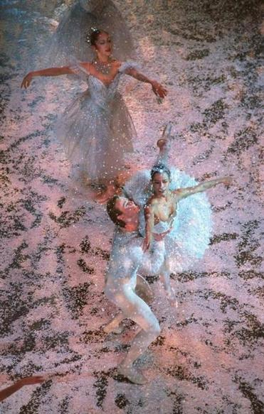 Snow falls on dancers in a 1996 Boston Ballet performance.