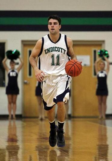 Lachlan Magee on the basketball court for Endicott College.