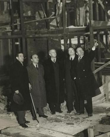"Norman Bel Geddes (pointing) during construction of the set for the 1937 stage production ""The Eternal Road."""