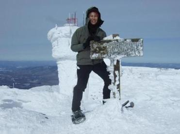 Betsy Whitmore of Holderness, N.H., at the summit of Mount Washington.