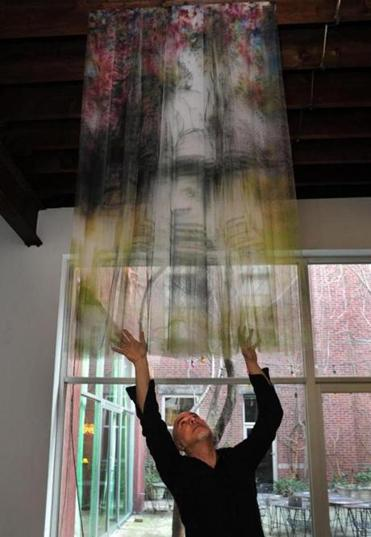 Artist Izhar Patkin with one of his pieces  at his home in the East Village of Manhattan.
