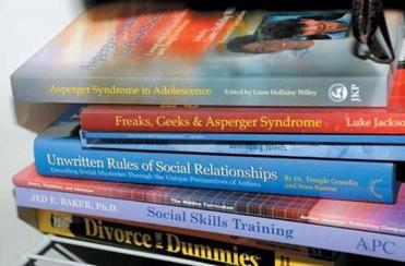 An evidence photo of a stack of books found in Adam Lanza's home.