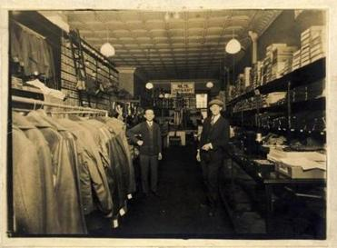 Joe Vogel (left) and a customer in the late 1920s.