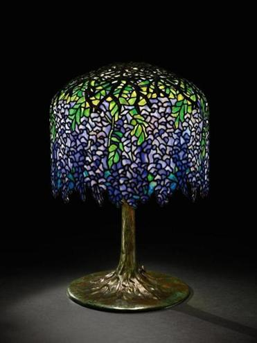 "An auction record for a Tiffany ""Wisteria"" lamp was set when this one sold at Sotheby's 20th-century design and decorative art auction for almost $1.6 million."