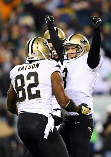 Saints kicker Shayne Graham rejoices with Benjamin Watson after hitting a game-winning 32-yard field goal as time ran out.