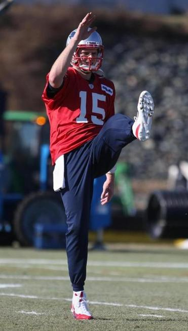 Ryan Mallett loosens up before what was a very busy practice day for him. Jonathan.Wiggs/ Globe Staff