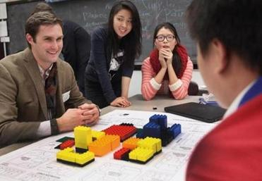 Urban planner Michael Keimig of the Urban Land Institute worked with Christina Huang, Miranda Zhou, and Aaron Wong on their mock development site.