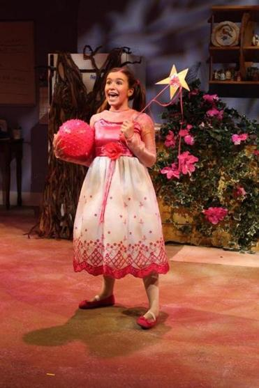 "Margaret McFadden, an eighth-grader, plays Pinkalicious Pinkerton, the girl obsessed with all things pink, in the Boston Children's Theatre production of ""Pinkalicious the Musical."""