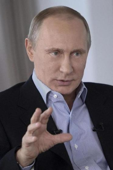 Russian President Vladimir Putin defended his nation's antigay law, which he said also covers pedophiles.