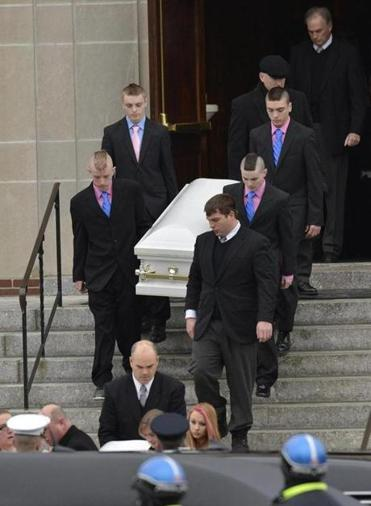 Mourners carried a casket at the funeral of Lexi and Sean Munroe, the Franklin siblings who suffocated in a hope chest.