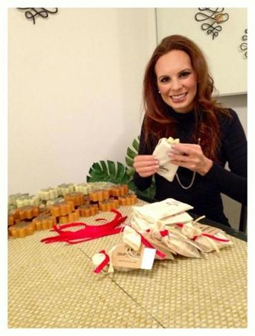 Erin Zaikis and some of her Sundara products. A portion of the proceeds helps fund public health initiatives overseas.