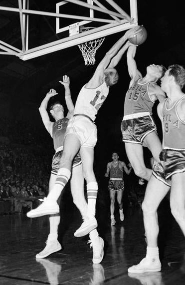 Mr. Gola (15) vied for a loose ball with Fort Wayne's George Yardley in an NBA championship series game in 1956.