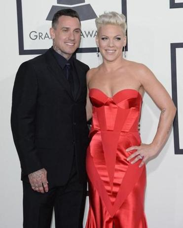 LOS ANGELES, CA - JANUARY 26: Singer Pink (R) and motorcycle racer Carey Hart attend the 56th GRAMMY Awards at Staples Center on January 26, 2014 in Los Angeles, California. (Photo by Jason Merritt/Getty Images)