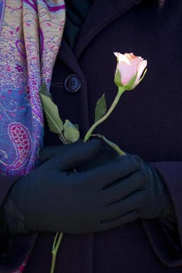 A woman held a flower at the Mall in Columbia after it was reopened to the public Monday.