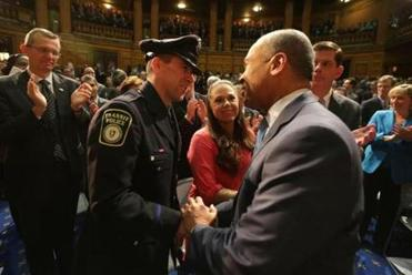 Governor Deval Patrick greeted MBTA Transit Officer Richard Donohue, who was injured in the gunbattle in Watertown following the Boston Marathon bombing last spring.
