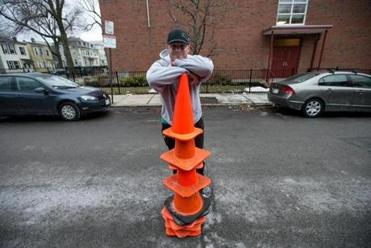 David Ivaska collected traffic cones on a 10-minute drive through South Boston during a light snowfall recently.