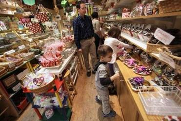 Cross, looked over a variety of candy and chocolates at Sweet Mimi's with his children.