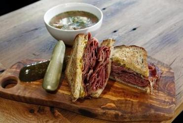 The Katz a pastrami sandwich with Mama Lils pickle mustard, sweet cheese on rye is photographed next to a bowl of matzo ball soup at Moody's Deli in Waltham, Massachusetts February 4, 2014. (Jessica Rinaldi For The Boston Globe)