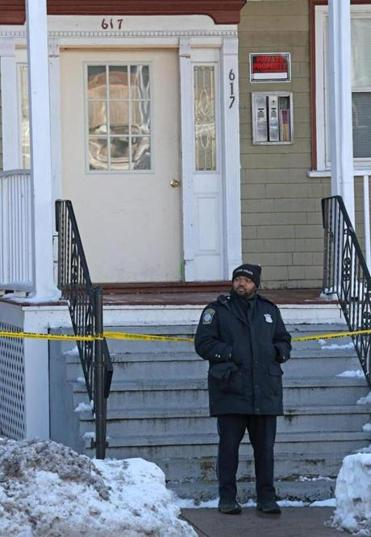 Police investigated the fatal shooting of a boy at the three-decker on Morton Street in Mattapan.