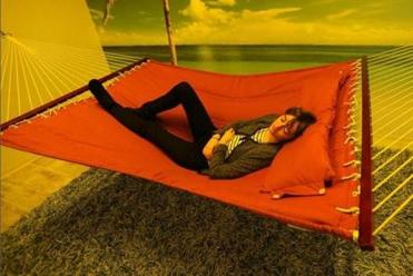Annabeth Carroll, senior support engineer at the Cambridge startup HubSpot, took a nap in the company's Van Winkle Room. The company opened the nap room at its offices in January. The room has a hammock, mood lighting, and walls painted with tropical island scenery. It is used about five times a day.