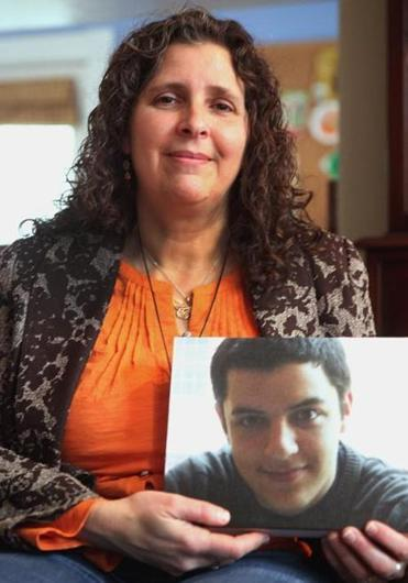 Cambridge resident Lise Stern holding a photo of her son Eitan Stern-Robbins, who died Unexpected Death in Epilepsy (SUDEP) on Valentine's Day 2013.