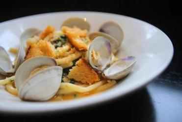 House-made bucatini with clams and garlic crumbs at Row 34.