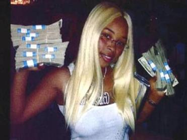 "Rashia Wilson posted on her Facebook page that she was ""the queen of IRS tax fraud."" This photo of her holding stacks of cash was used as evidence in a case in which she pleaded guilty to theft charges."