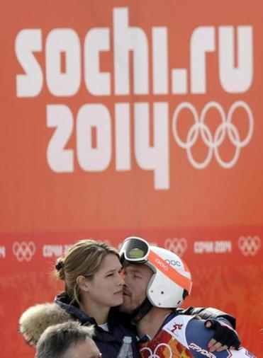 Bode Miller hugs his wife, Morgan, after he finished 20th in the giant slalom. He will not race in Saturday's slalom.