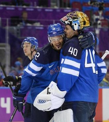 Olli Jokinen (left) embraces Tuukka Rask, who made 37 saves for victorious Finland.