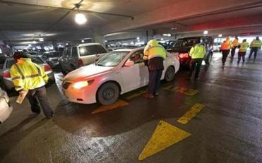 Airport parking facilities are pushed to the limit during school vacation week, forcing valets to use the aisles, too.