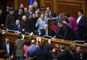 A heated Ukrainian Parliament approved an accord to grant amnesty to protesters and allow the release of former prime minister Yulia Tymoshenko.