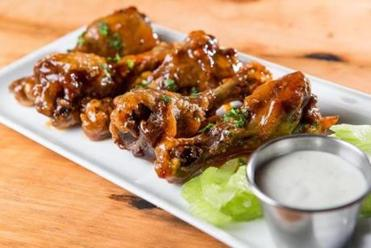 The maple-chili duck wings.