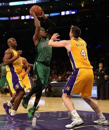 Rajon Rondo (center) went for a shot as he was defended by Ryan Kelly (right) and Jodie Meeks in the first half.