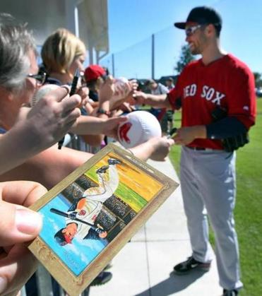 Early in camp, a fan hoped Grady Sizemore would sign a card from his Indians days.
