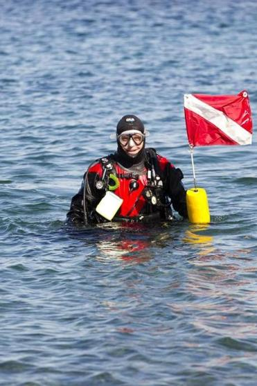 Doctoral student Chris Marks braving the ocean in February to collect samples for the Marine Science Center in Nahant.