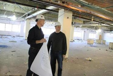 John Kucinski, Constant Contact's senior facilities manager (left), and Andy Miller, its chief innovation architect, inspected the company's expansion in Waltham, which will house startups as well as Constant Contact employees.